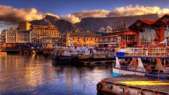 "Cape Town, Africa | Why go: While many families travel to Cape Cod for spring break, try a new kind of Cape: one with rings of mountain ranges, rolling vineyards, and untouched beaches. In the central part of Cape Town, blends of nationalities and cultures create what is hailed as South Africa's capital of gastronomy, nightlife, and jazz music. To make it educational, tour Nelson Mandela's jail cell or visit a museum dedicated to District 6, a neighborhood that was declared ""white"", forcing thousands of displaced African citizens into shacks or out onto the streets. It's impossible to understand the now vibrant Cape Town without exploring its somber past."