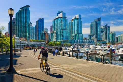 "Vancouver, Canada | Why go: Vancouver is a fairly young city, but it's quickly becoming the back drop for TV series and movies; some even go as far to call it the ""new Hollywood."" From hiking, mountain biking and kayaking to visiting the Granville Island or the Capilano Suspension Bridge, there's a little something for everyone in Canada. Make sure to try the poutine on your way home!"